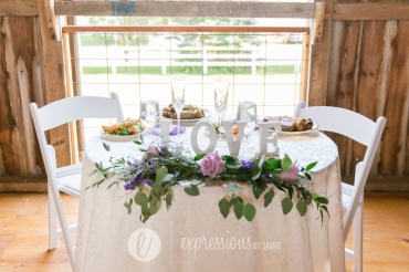Sweetheart table with flowers by Fiddlestix